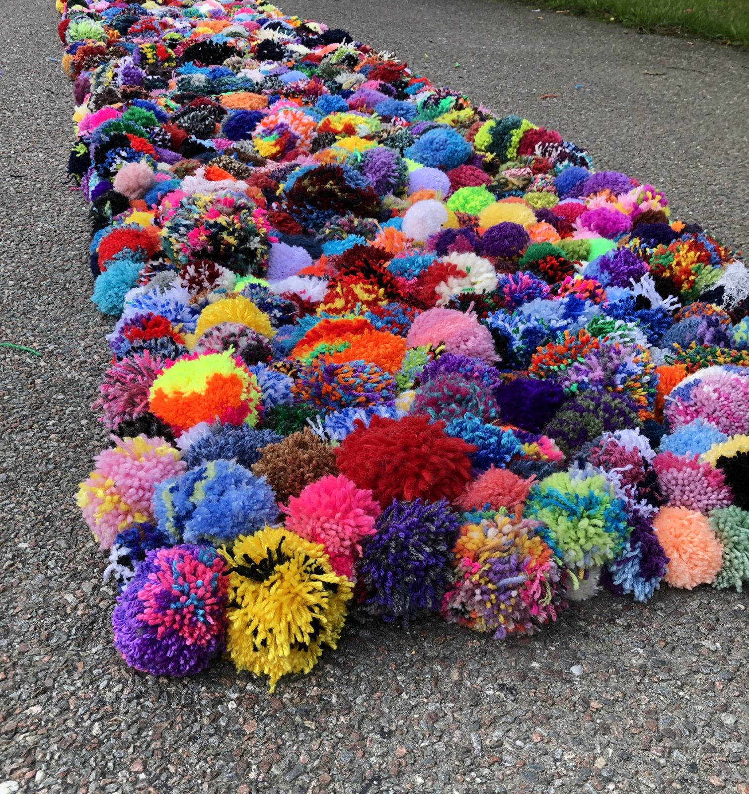 Swedish-carpet-consisted-of-3-136-pompoms